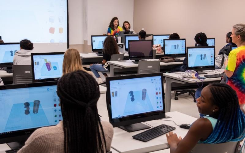 Attendees from the annual Girls Day Out (GDO) learn about 3D modeling and printing at the College of Charleston in 2018. More than 100 girls from four Lowcountry school districts attended the camp, hosted by Space and Naval Warfare Systems Center (SSC) Atlantic in collaboration with Trident Technical College via Cyber Secure, College of Charleston, Bosch, Naval Health Clinic Charleston, Paul Mitchell the School Charleston, and Nucor Steel Berkeley. U.S. Navy photo by Joe Bullinger/Released