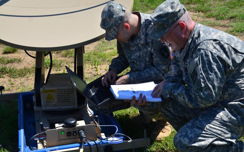 U.S. soldiers assemble a Very Small Aperture Satellite Terminal  (VSAT ) similar to the one Army Medical Command personnel rely upon for telemedicine support when forward-deployed.