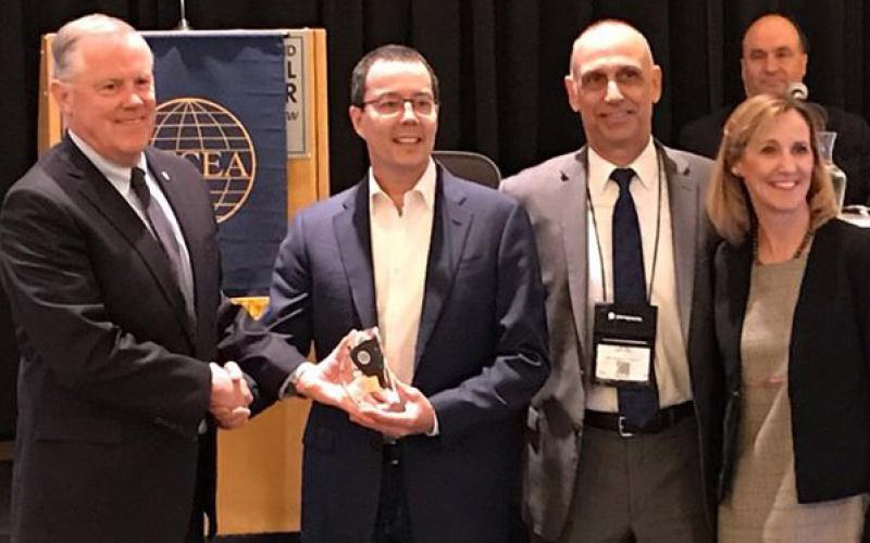 From l-r, Lt. Gen. Robert Shea, USMC (Ret.), president and CEO of AFCEA International, presents the winner's trophy to Mike Fong, CEO of Privoro, after his company's technology was chosen as the top competitor in the championship round of AFCEA International's small business innovative shark tank. Also present are John Kreger of MITRE, chairman of the AFCEA Homeland Security Committee and Tina Jordan, AFCEA vice president of membership.