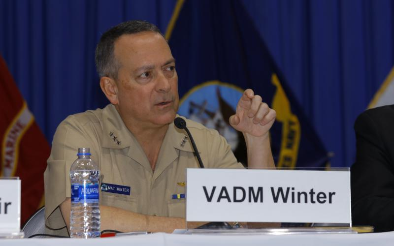 Vice Adm. Mathias Winter, USN, Joint Strike Fighter program director, speaks on a panel at West 2019. Photo by Michael Carpenter