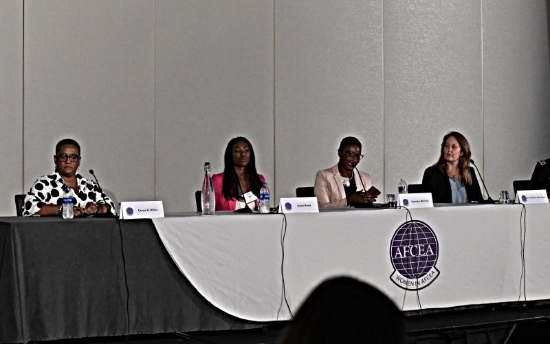 """Tina Jordan, vice president of Membership for AFCEA International, introduces speakers for the """"Girls and Women in STEM: How Do We Get the Girls' Attention?"""" panel, moderated by Essye Miller, retired DoD principal deputy chief information officer, seated far left. Panelists, from l to r, included Aisha Bowe; Kameke Mitchell; Christine Anne Royce; and Lt. Col. Julianna Rodriguez, USA. Photo by Elizabeth Moon"""
