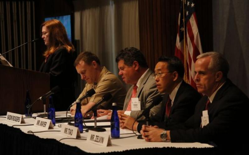 (l-r) Rear Adm. Betsy Hight, USN (Ret.) moderates a panel comprising Vice Adm. Michael Rogers, USN, U.S. Fleet Cyber Command; Robert Mayer of the U.S. Telecom Association; Paul Tiao of the law firm Hunton and Williams; and Larry Zelvin of the Department of Homeland Security