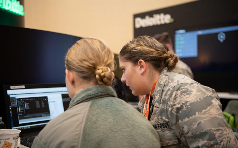 Students from the U.S. Air Force Academy's Cyber Competition Team Delograndest consider their approach during the Capture the Flag event sponsored by Deloitte at the AFCEA Rocky Mountain Cyber Symposium on February 5. Credit: Brandy Ragas, Royal Magnolia Photography