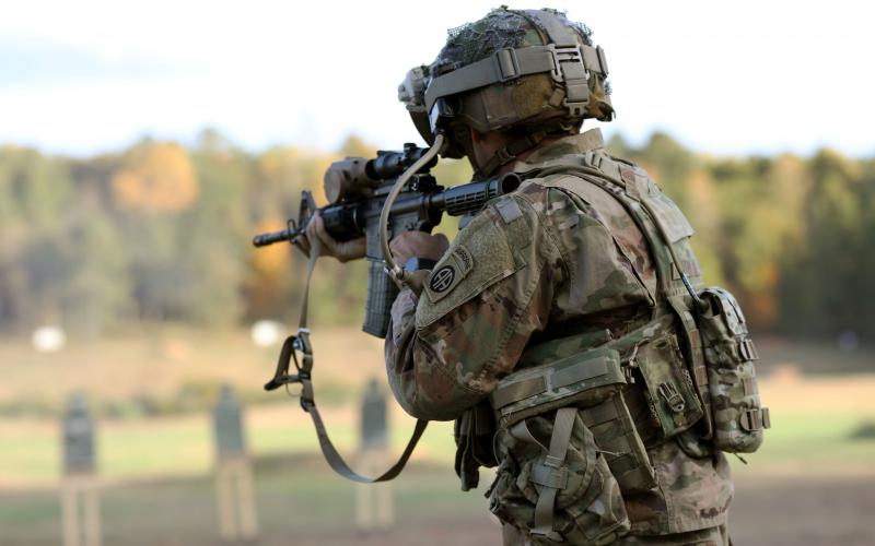 A soldier dons the prototypical Integrated Visual Augmentation System during a live fire test event at Fort Pickett, Virginia, in October 2020. The Silicon Anode Conformal Wearable Battery prototype is placed in the soldier's back pouch. Army officials will assess two versions of the new battery during Project Convergence 2021 in October. Credit: Courtney Bacon, PEO Soldier PAO