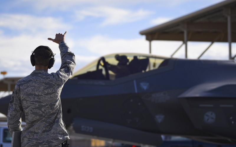 Master Sgt. Thomas Puckett, USAF, 7th Aircraft Maintenance Squadron, Lightning Aircraft Maintenance Unit section chief, sends off an F-35 Lightning II fighter jet assigned to the 6th Weapons Squadron at Nellis Air Force Base, Nevada. The Air Force has made the Shadow Operations Center at Nellis the location validating its Joint all-domain command and control. U.S. Air Force photo by Airman 1st Class Andrew Sarver