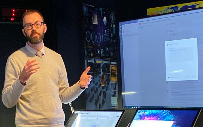 Joel Day, account technology strategist, demonstrates analysis collaboration using a custom Microsoft Teams application. (Photo courtesy of Microsoft Corporation)