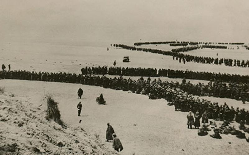 Thousands of British and French troops wait on the dunes of Dunkirk Beach, France, for transport to England during World War II, between May 26 and June 4, 1940. The Central Intelligence Agency cites the military evacuation of Dunkirk as the time its predecessor agency started depending on the private sector for key strategic intelligence. Credit: Shutterstock/Everett Historical