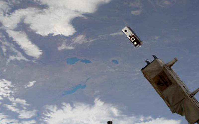 A DARPA cubesat placed into orbit from the International Space Station contains an experiment in which microelectronic mechanical systems (MEMS) change the mirror shape of an optical system to generate high-quality imagery. Space is just one area in which the agency is boosting its research to meet new challenges. Credit: NASA photo