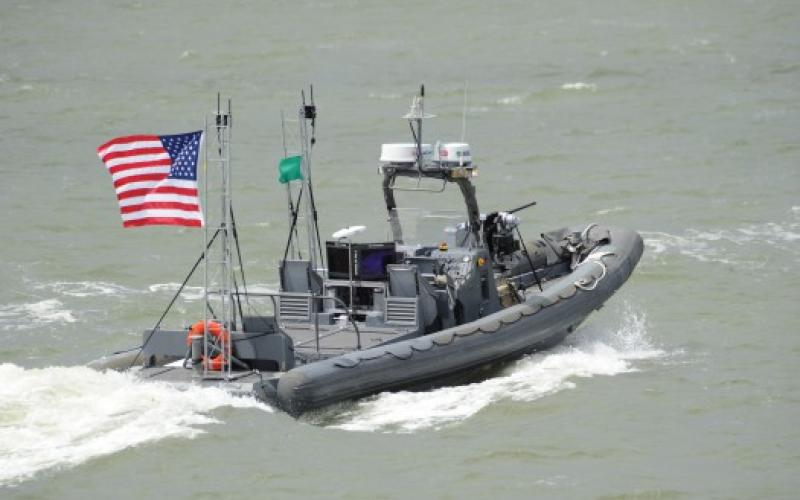 An unmanned boat from Naval Surface Warfare Center Carderock operates autonomously during a demonstration of swarmboat technology being developed by the Office of Naval Research.
