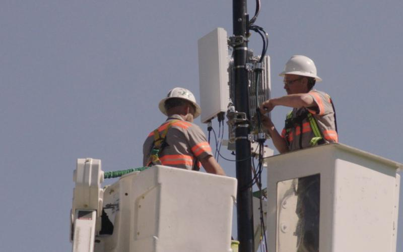 Technicians from Verizon install a 5G node in Indianapolis. The different bandwidths offered by the new cell technology offer a host of new capabilities for commercial and military users.  Verizon