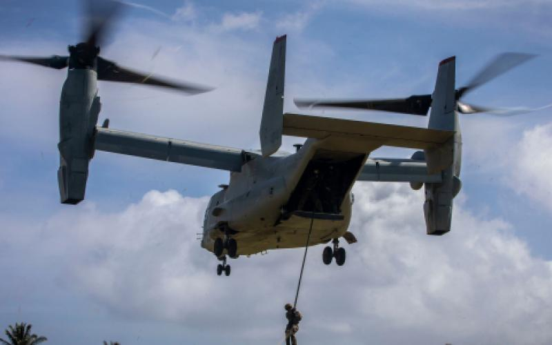 A U.S. Marine with 2nd Battalion, 3rd Marine Regiment, fast ropes from a MV-22B Osprey during drills in November at Marine Corps Base Hawaii. Technologies fielded by the service's Command Element Systems must be lightweight and effective for expeditionary forces.  U.S. Marine Corps photo by Cpl. Matthew Kirk, USMC
