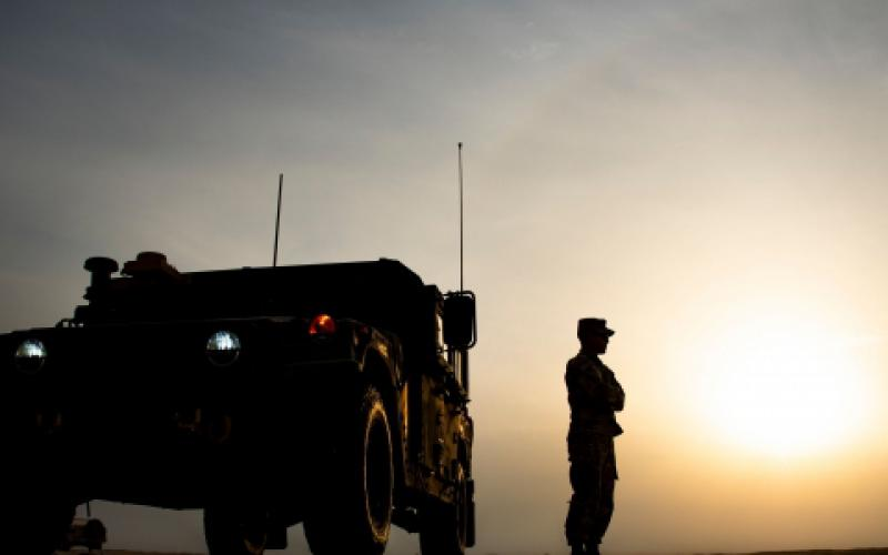 A U.S. Army soldier stands outside a Humvee before the start of the Dasman Shield live fire exercise in Kuwait in February. During the exercise, the military looked at the beginnings of all domain operations, including air-to-ground command control, as well as partner interoperability with Kuwaiti forces.  U.S. Air Force photo by Senior Airman Kevin Tanenbaum