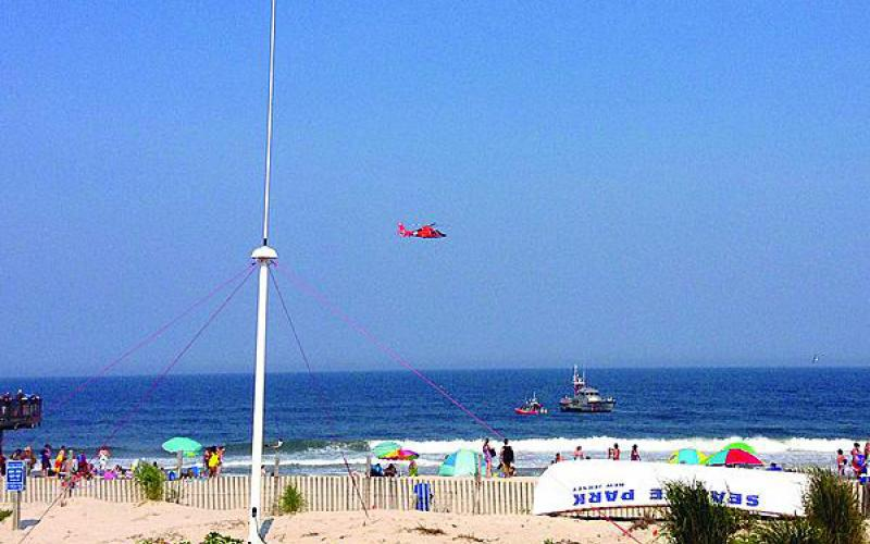 As Coast Guard vessels and a helicopter patrol the waters off a beach in New Jersey, a CODAR SeaSonde HF radar scans the ocean to provide vital sea state information to NOAA.