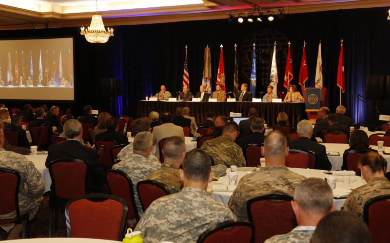 Attendees list as industry panelists present thoughts on the military's effort to streamline cybersecurity efforts at AFCEA International's TechNet Augusta conference in Georgia. Photo by Mike Carpenter