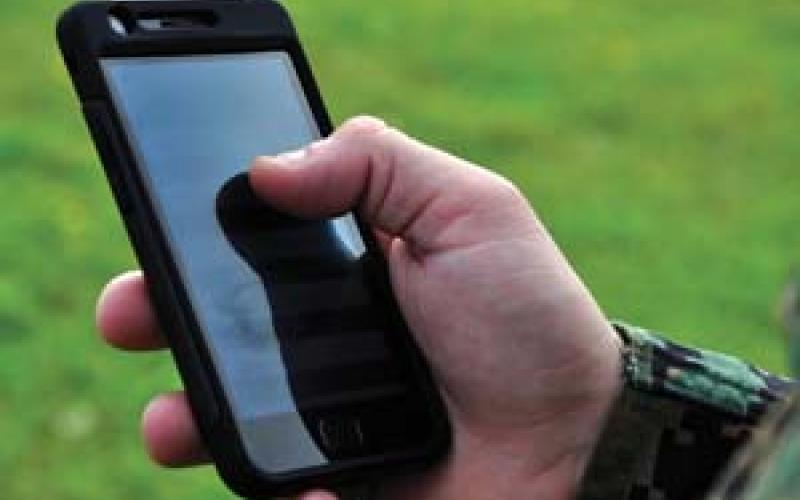 A U.S. Marine experiments with Lighthouse software on a mobile device.