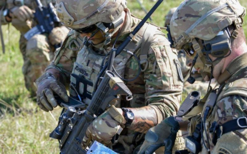 1st Lt. Zachary Johnson, USA (l), uses a Nett Warrior end-user device during air assault training as part of Exercise Saber Junction 2018 at the Grafenwoehr Training Area, Germany. 1st Lt. Johnson is assigned to the 1st Battalion, 503rd Infantry Regiment, 173rd Airborne Brigade, one of several units evaluating the Integrated Tactical Network (ITN) during operational exercises to help inform design decisions for future Infantry, Stryker and Armor formations.  U.S. Army photo/Spc. Rolyn Kropf, USA