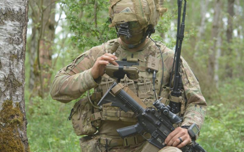 1st Lt. Michael Austin, USA, platoon leader for Attack Company, 1-503rd Infantry Regiment, 173rd Airborne Brigade, uses the Nett Warrior end-user device to report information to his company commander through the ITN during a live-fire exercise in Grafenwoehr, Germany.  U.S. Army photo/Spc. Joshua Cofield, USA