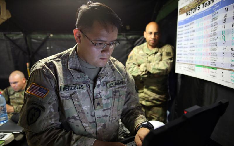 Sgt. Rogelio Hercules, USA, the Network Operations noncommissioned officer in charge assigned to Alpha Company, 44th Expeditionary Signal Battalion, 2nd Theater Signal Brigade, configures a router for the 648th Maneuver Enhancement Brigade, Georgia National Guard, at its forward command post to enable mission command for a river crossing during exercise Saber Guardian 17. U.S. Army photo by Staff Sgt. Brian Cline