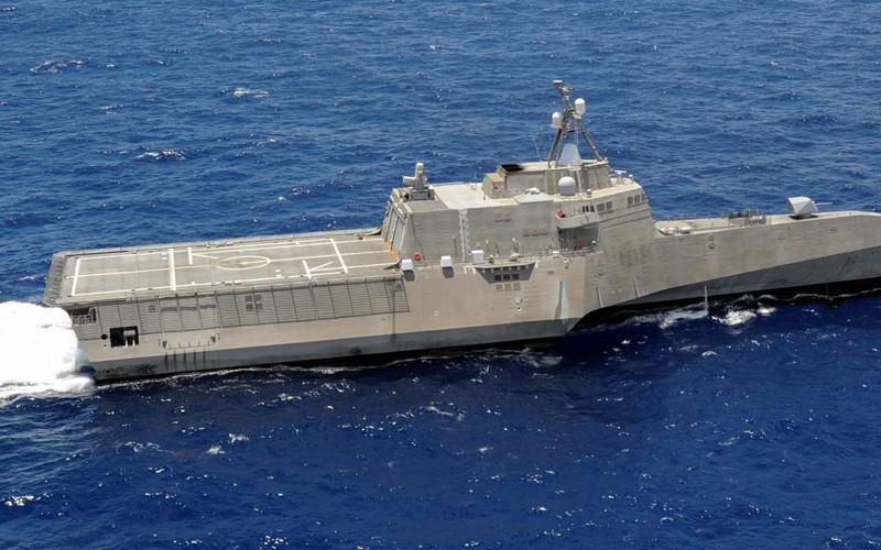 The U.S. Navy's USS Independence, LCS-2 (r) looks similar to a new Chinese littoral combat ship, or C-LCS, shown in the prior photo. China has introduced new classes of catamarans and trimarans for coastal operations.