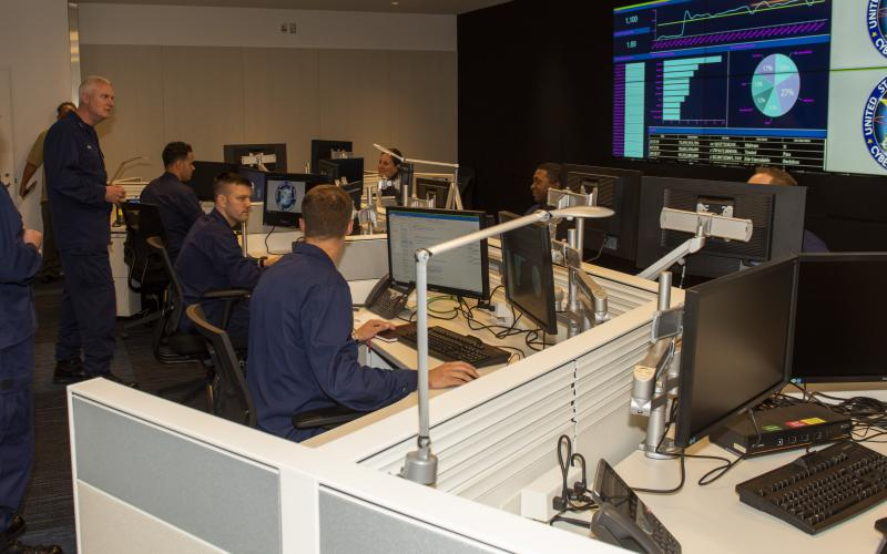 The addition of cyber offense capabilities by the U.S. Coast Guard Cyber Command marks another step in the service's growing cyber versatility, says the leader of the command, Rear Adm. Michael Ryan, USCG (l), speaking to Coast Guardsmen in the command's Cyber Operations Center in Washington, D.C. Credit: USCG Cyber Command
