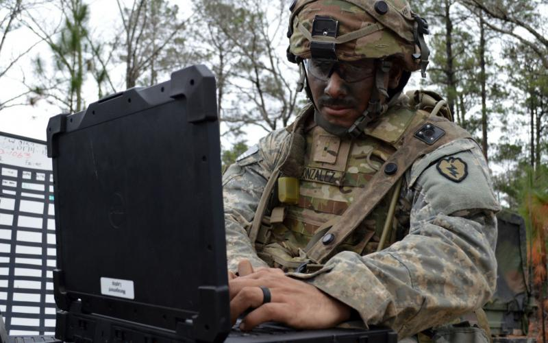 A U.S. Army soldier tests his battle systems in the field at Fort Polk, Louisiana. Credit: Army photo by Staff Sgt. Armando R. Limon, 3rd Brigade Combat Team, 25th Infantry Division