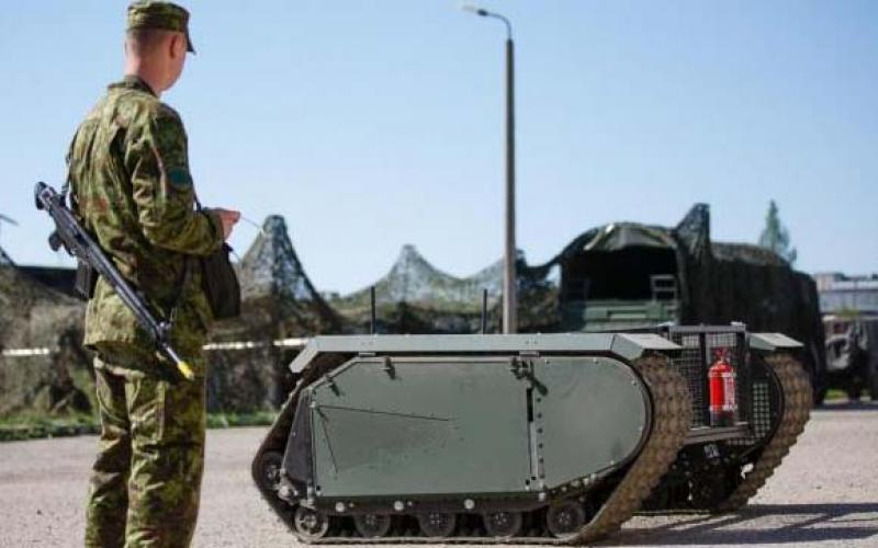 An Estonian soldier tests the THeMIS unmanned ground vehicle during a spring battlefield exercise.