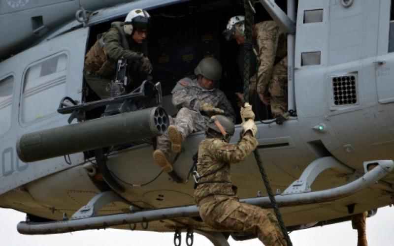 Soldiers with the 25th Infantry Division conduct fast rope insertion extraction techniques with their Marine Corps and Air Force counterparts. Elements of the 25th participated in the Army's recent Cyber Blitz exercise, which will help define the future of cyber and spectrum warfare.