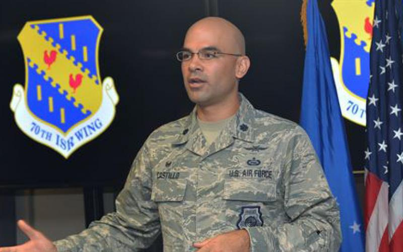 Lt. Col. Matthew Castillo, USAF, commander, 35th Intelligence Squadron, speaks about the Cyberspace Threat Intelligence Center during the facility's ribbon-cutting ceremony. Airmen and contractors with the 35th IS will conduct operations from the new facility.