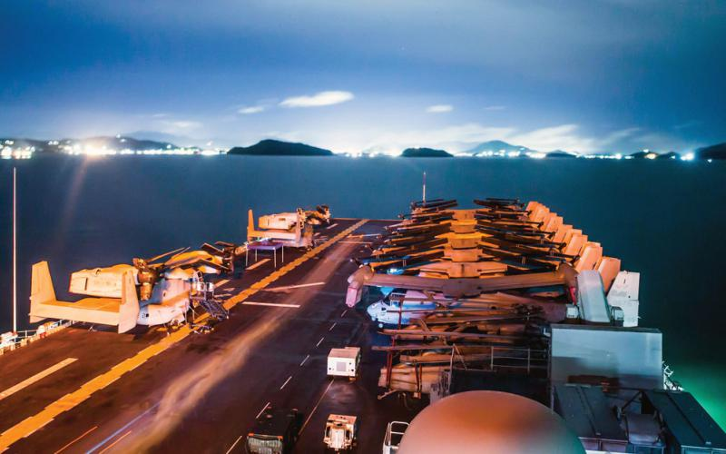The amphibious assault ship USS Boxer anchors off the coast of Phuket, Thailand. The U.S. Indo-Pacific Command is advancing the quality of technology in multinational training exercises, so allies and partners can interoperate in cyber the way they might have to in regional operations. U.S. Navy photo