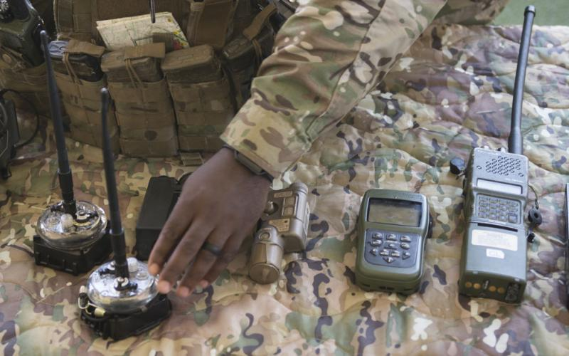 U.S. Special Operations Command (SOCOM) personnel and partner nation representatives examine SOF radio equipment at Air Force Special Operations Command. SOCOM seeks radios that are independent of partners or places so that SOF operators on the move can communicate seamlessly.