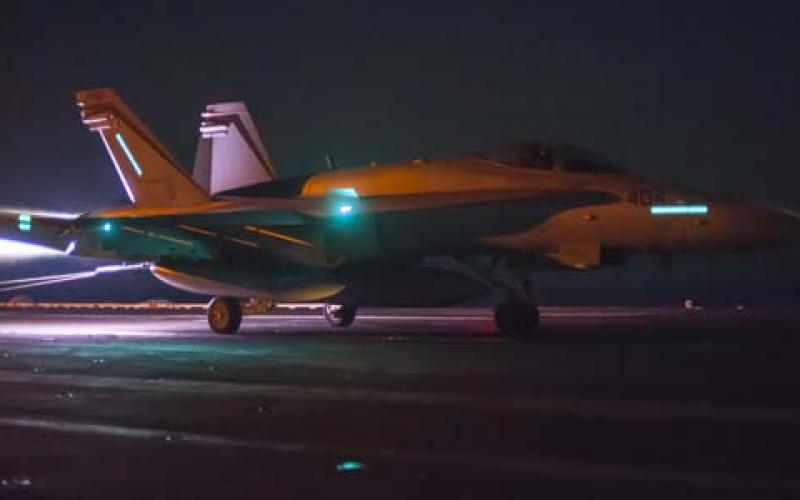 An F/A-18C Hornet lands on the flight deck of the USS Carl Vinson during night operations. In the event of a joint operation, Navy cyber forces might be called upon to conduct operations in combatant command networks as well as their own.