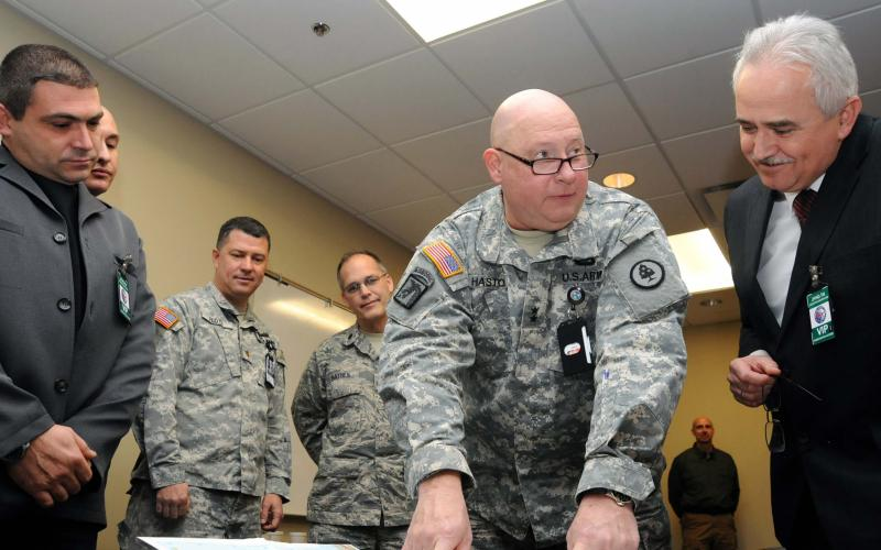 "Tennessee's adjutant general, Maj. Gen. Terry ""Max"" Haston of the Army National Guard, reviews a map of Bulgaria's area of operation with Bulgarian Armed Forces cybersecurity officials at Tennessee's Joint Force Headquarters in 2014. Bulgaria is investing in a national cyber defense system and collaborating with the U.S. government to mirror efforts such as optimizing public-private partnerships."