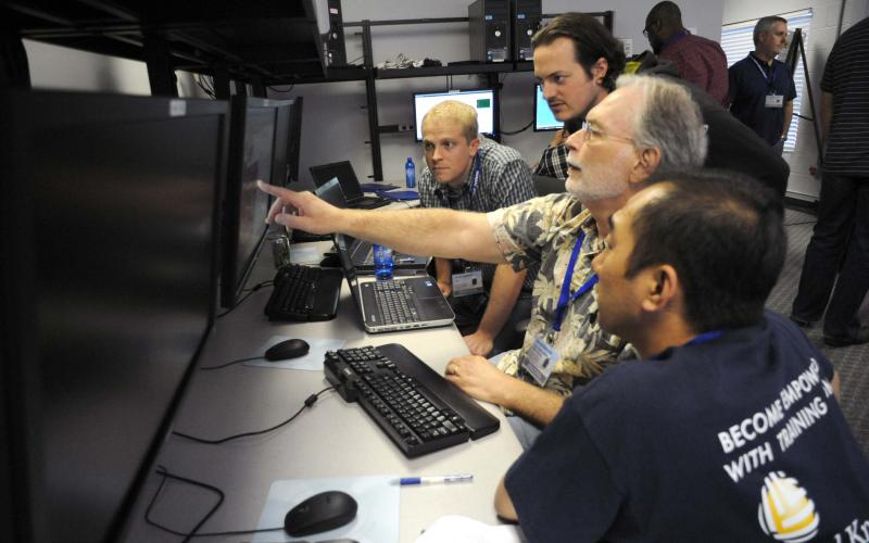Government and private sector industrial control systems (ICS) professionals participate in an ICS cybersecurity training exercise at the Department of Homeland Security's Industrial Control Systems-Cyber Emergency Response Team (ICS-CERT) training facility in Idaho Falls, Idaho.