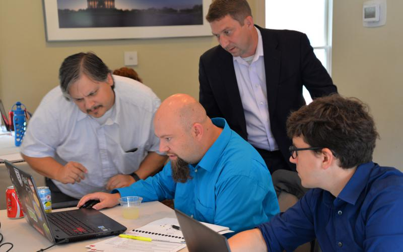 ManTech  conducts a cyber testing and training exercise with cyber experts from the financial sector.