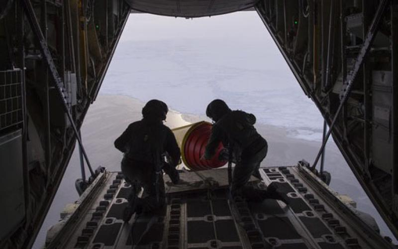 One way international military and government agencies gather information about weather and oceanographic data to enhance forecasting and environmental models is through networked buoys. The Royal Danish Air Force deployed these ice-hardened buoys from a C-130 into the Arctic Ocean in September as part of the International Arctic Buoy Program. Credit: John F. Williams