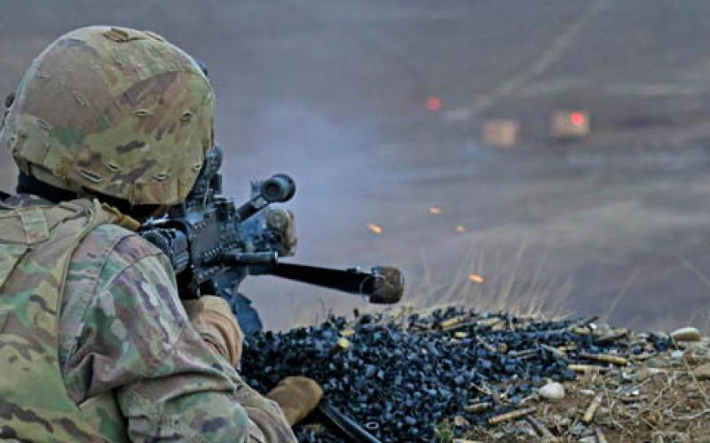 A soldier fires an M240B machine gun during combined arms live-fire training. Soldiers in combat face a great deal of emotional and physical stress, but wearable technologies can monitor their health and performance. Photo by Army Spc. Hannah Tarkelly