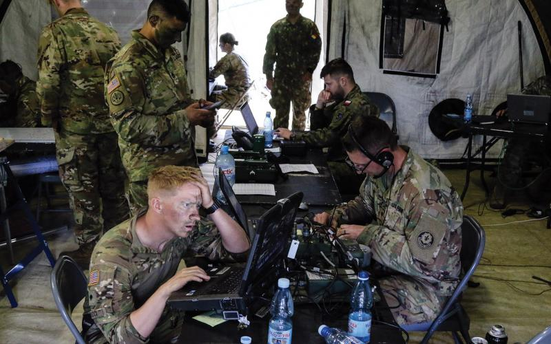 U.S. soldiers with 1st Squadron, 2nd Cavalry Regiment, coordinate troop movements inside of the tactical operations center with Battle Group Poland at Bemowo Piskie Training Area, Poland, as part of NATO exercise Saber Strike 18. This year's exercise tested allies and partners from 19 countries on their ability to collaborate to deter aggression in the region. U.S. Army photo by Spc. Hubert D. Delany III /22nd Mobile Public Affairs Detachment