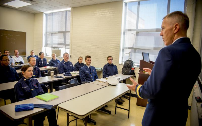 Rear Adm. Kevin Lunday, USGC, commander of Coast Guard Cyber Command and assistant commandant for Command, Control, Communications, Computers and Information Technology (C4IT), speaks to Coast Guard Academy electrical engineering cadets about CG Cyber.