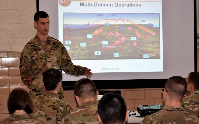 Maj. John Rodriguez, USA, an experienced information operations officer, touches on the unification of information-related capabilities in a multidomain battlefield environment demonstrated in the Cyber Blitz exercise. The exercise provides U.S. Army Cyber the opportunity to test new concepts, capabilities and techniques in offensive and defensive cyberspace operations to electronic warfare and information operations, the major says. Credit: Maj. Kurt Rauschenberg, ARNG