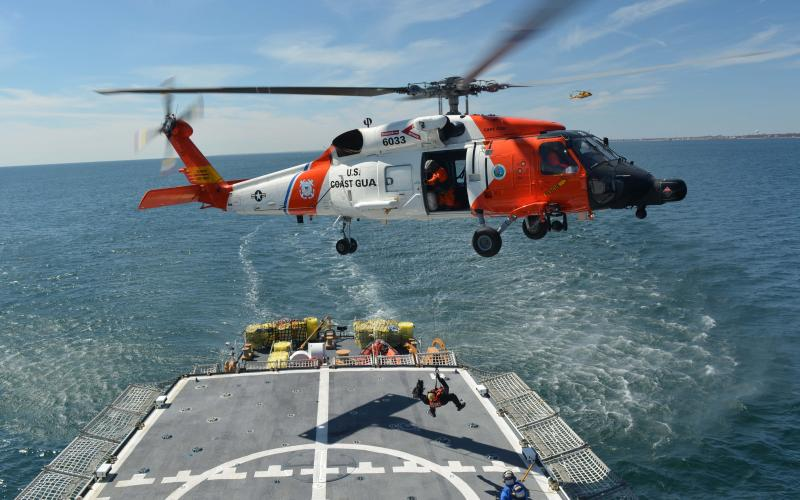 A U.S. Coast Guard helicopter and the Coast Guard Cutter Seneca conduct joint operations with the Air National Guard and Canadian Forces. Deterring and defending against the international threat to the homeland will require expanded global cooperation.