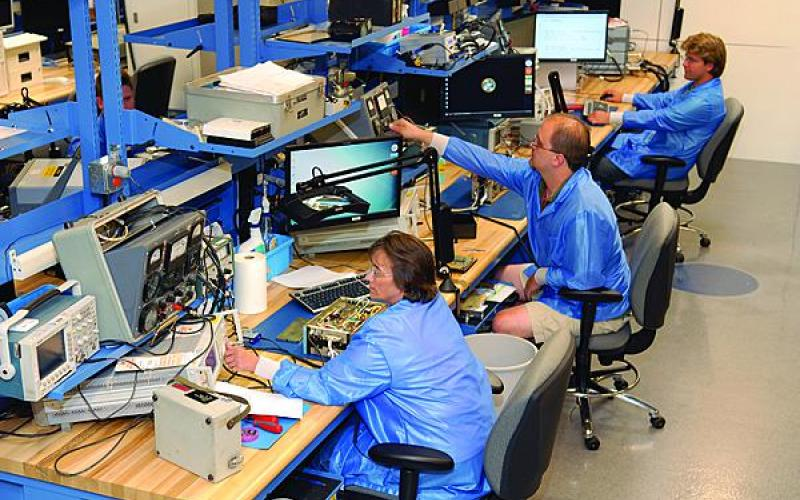 Technicians at Tobyhanna Army Depot work on communications-electronics systems in the Depot Maintenance of the Future (DMOF) facility. The 10,000-square-foot center, which serves as a working laboratory for new technology and processes, is designed to stimulate new ideas and work techniques.