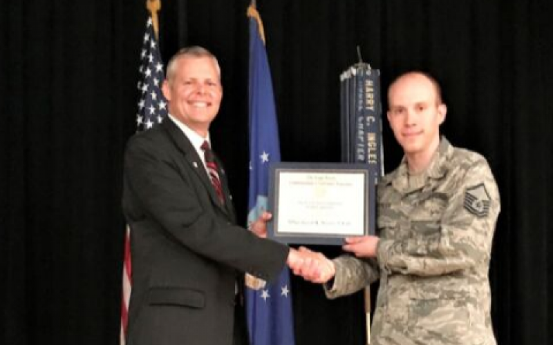 Master Sgt. Jason K. Stover, USAF (r), accepts his AFCEA War Veterans Scholarship from Rick Lipsey, president, Alamo Chapter. Sgt. Stover is pursuing a bachelor's degree in computer science from Trident University.