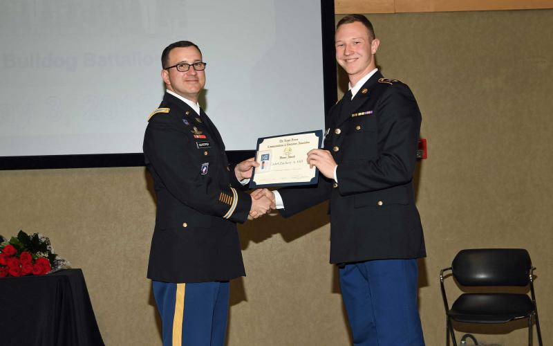 Lt. Col. Tim Culpepper, USA, professor of military science at Gonzaga University (l), presents an Honor Award to Cadet Zachary A. Hill, Army ROTC.