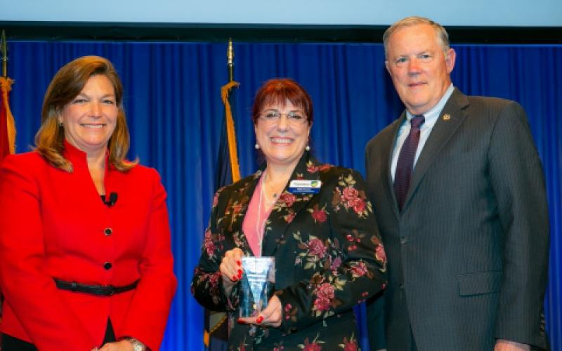 Col. Kathy Swacina, USA (Ret.) (c), receives the 2019 Women's Appreciation Award from DeEtte Gray, AFCEA chairwoman of the board, and Lt. Gen. Robert Shea, USMC (Ret.), AFCEA president and CEO.
