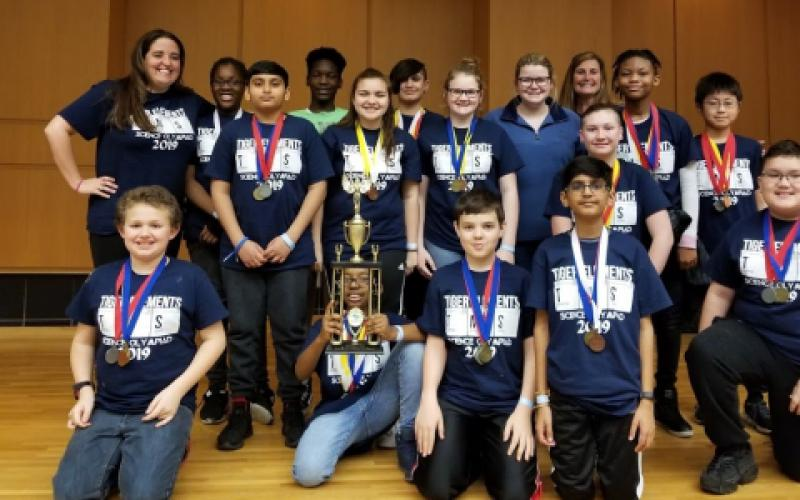 Thomson Middle School's Olympiad team in Warner Robins, Georgia, won second place in the regional competition after showcasing their skills in STEM areas such as herpetology (r) and engineering and building a boomilever (l). Their victory was made possible by a 2018 Gravely Grant.