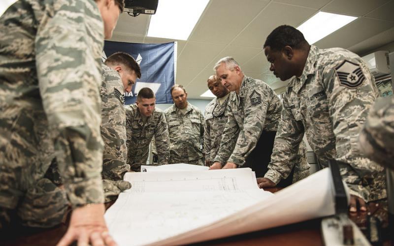 U.S. airmen from the 202nd Engineering Installation Squadron (EIS), Georgia Air National Guard (ANG), and the 241st EIS, Tennessee ANG develop a strategy to evaluate underground communications infrastructure at Muñiz ANG Base in San Juan, Puerto Rico. The 202nd EIS deployed to the Puerto Rico Air National Guard's 156th Airlift Wing as part of the hurricanes Irma and Maria recovery and provide a cost-effective solution to bolster and protect the communication infrastructure. U.S. Air National Guard photo by