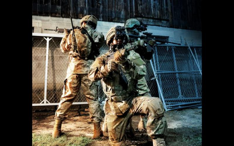 Three soldiers from different forces are equipped with the Integrated Soldier System (ISS) that links the i-Aware TM-NVG night vision system with the SpearNet radio. Combining night vision with radio communications allows warfighters to send real-time battlefield imagery back to their headquarters as well as receive other situational awareness imagery and information from their commands.