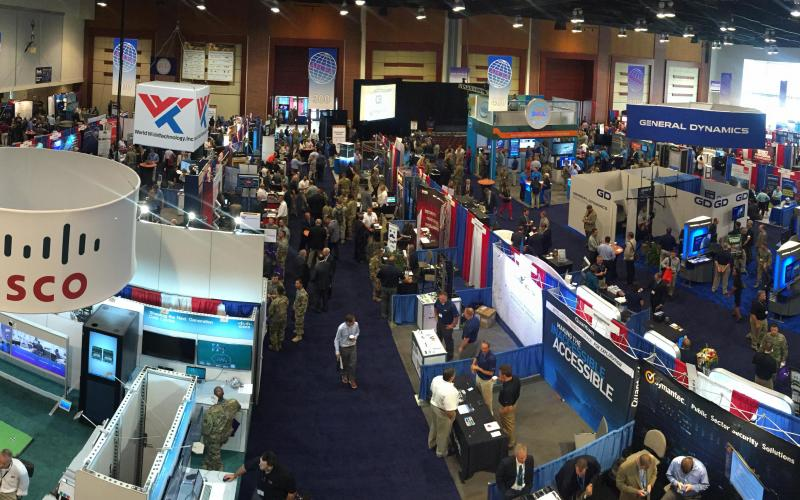 Attendees of AFCEA's TechNet Augusta 2016 network on the exhibit floor. The symposium enables participants to understand the challenges the cyber element introduces into a combat arms fight.