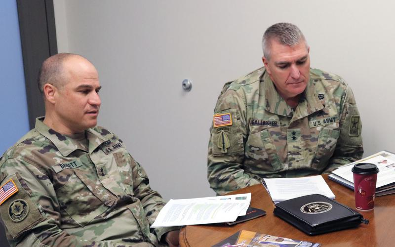 Maj. Gen. David Bassett, USA (l), and Maj. Gen. Peter Gallagher, USA, are working closely together to harness the service's new cross-functional teams to drive innovation. Photo Credit: Bridget Lynch, PEO C3T