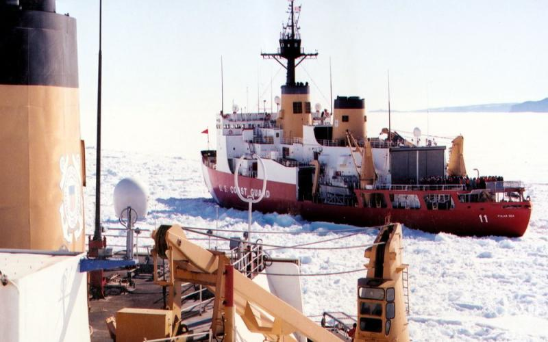 The Coast Guard's Cyber Command protections have to cover the service's operations and assets across the globe, even in the polar regions of the Arctic and Antarctica. Pictured is the Coast Guard Ice Breaker Polar Sea passing the Coast Guard Ice Breaker Polar Star in the ice channel near McMurdo, Antarctica. Credit: USCG photo by Rob Rothway